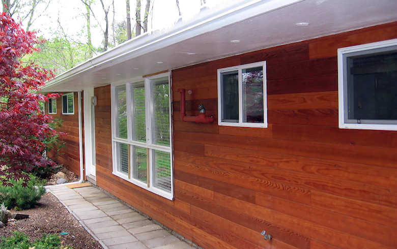 Redwood siding on a ranch style home